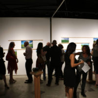 Visitors at the Landscape in Motion opening reception.